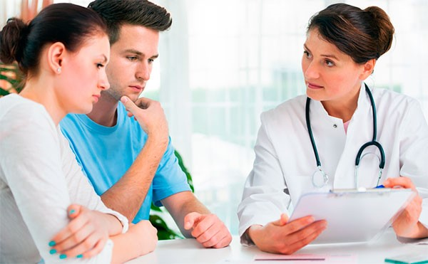 a couple consulting with a doctor